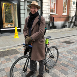 Man with hat and bike at Covent Garden
