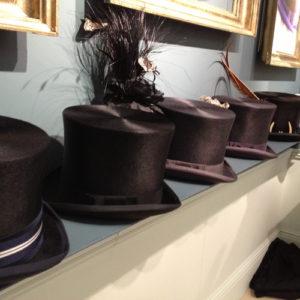 Vintage top hats on display